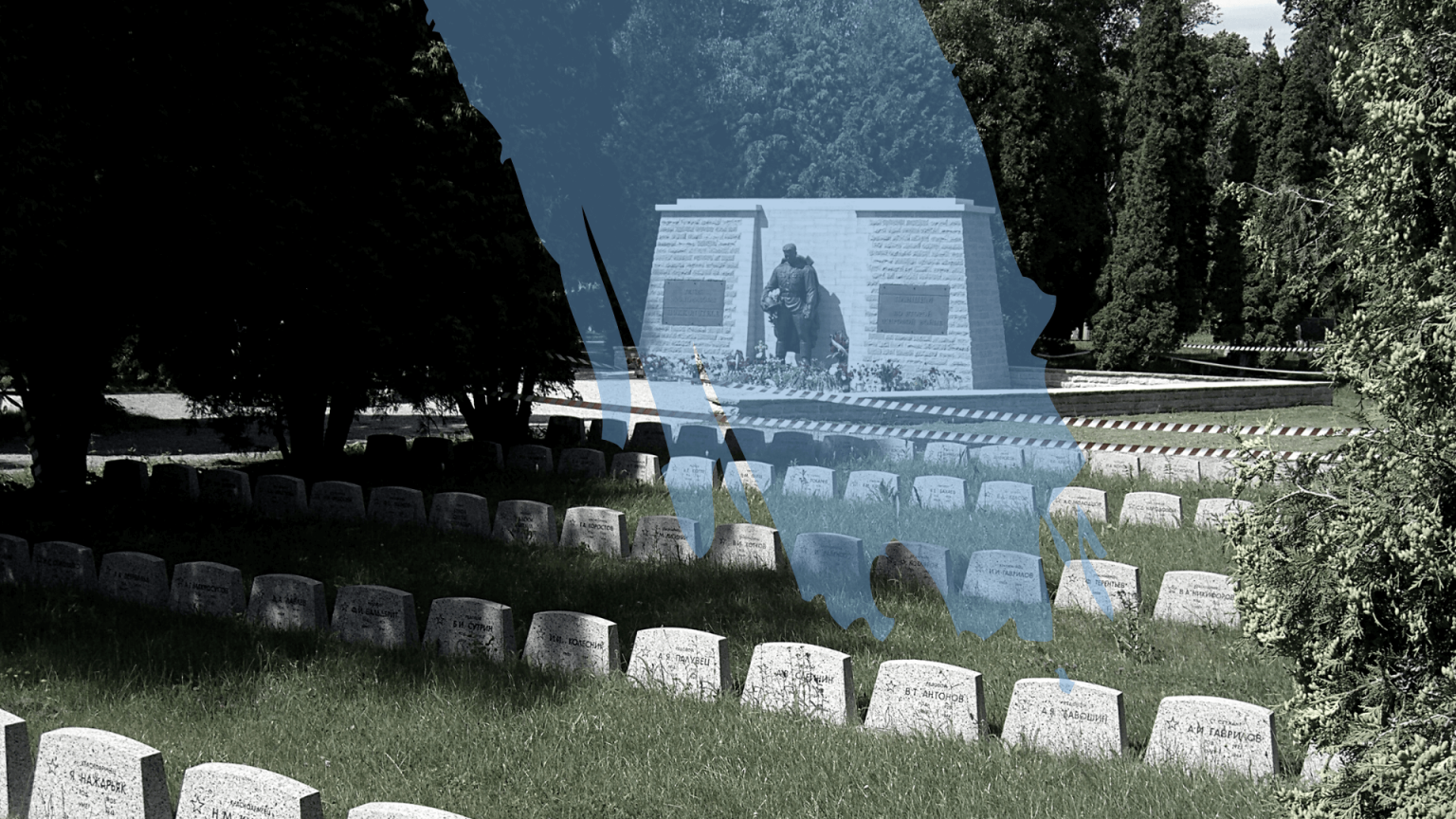 The bronze soldier statue at its new location, the Tallinn Military Cemetery. The image has been edited with a translucent splash of blue paint across the statue.