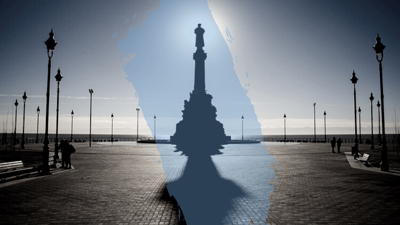 Statue of Christopher Columbus stands in its new location at the Río de la Plata, looking out towards the ocean - in the direction of Spain. The image has been edited with a translucent splash of blue paint across the statue.